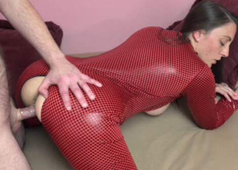 Melanie's in a red catsuit while she fucks